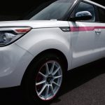 white Kia Soul with red RimBlades rim protectors