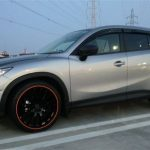 silver SUV with red RimBlades wheel rim protectors