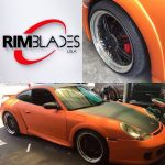 orange and black sports car with silver RimBlades rim protectors