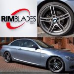 metallic blue BMW with silver RimBlades rim protectors