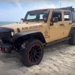 tan Jeep with red RimBlades rim protectors