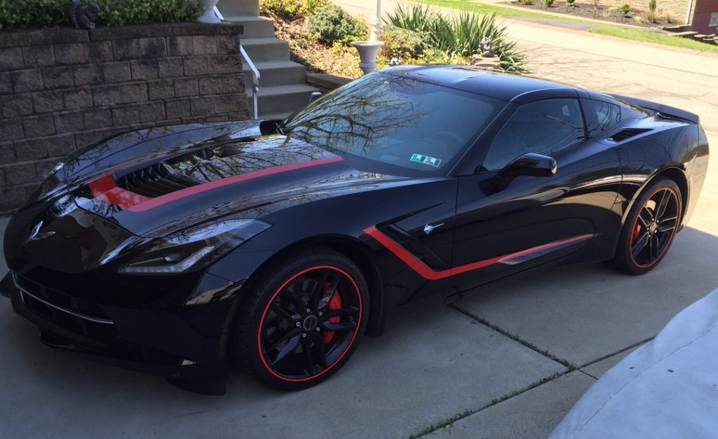 2014 Chevy Corvette with red RimBlades wheel rim protectors