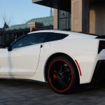 white Chevy Corvette with red RimBlades rim protectors on wheels