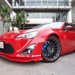 red Toyota with red RimBlades