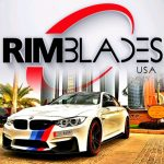 white BMW with red rim protectors from RimBlades USA