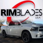 white pickup truck with white RimBlades USA rim protectors on wheels