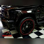 black Biturbo truck with red RimBlades rim protectors
