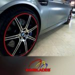 metallic blue BMW with red RimBlades rim protectors