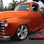 orange hot rod truck with orange RimBlades rim protectors