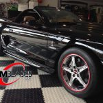 black Shelby Cobra with red RimBlades rim protectors