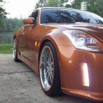 orange RimBlades wheel rim protectors on Nissan 350