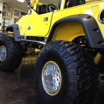 yellow Maui Off Road jeep with yellow RimBlades rim protectors