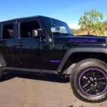 black JEEP Wrangler with purple RimBlades rim protectors