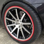 red RimBlade rim protectors on Aston Martin