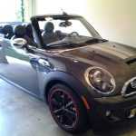 black Fiat convertible with red RimBlades rim protectors