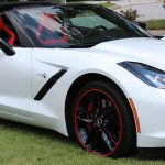 white Chevrolet Corvette with red RimBlades wheel rim protectors