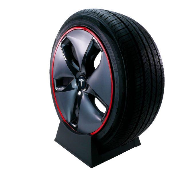 Red RimSaver installed on a Tesla Model 3 Aero wheel